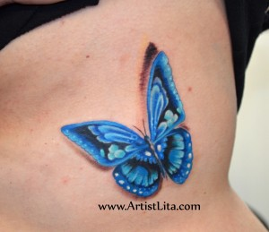 Electric Blue Butterfly on ribs